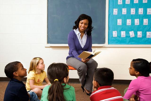 Teacher reading aloud to students